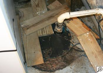 An ugly, clogged sump pump system in Layton, Utah
