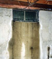 Flooding through basement windows in a Vernal home.